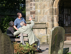 Admiring Hathersage church where his ancestors are buried.